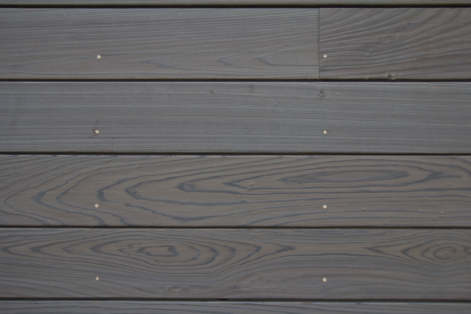 shou sugi ban sureto dark grey exterior siding on beach house in longport