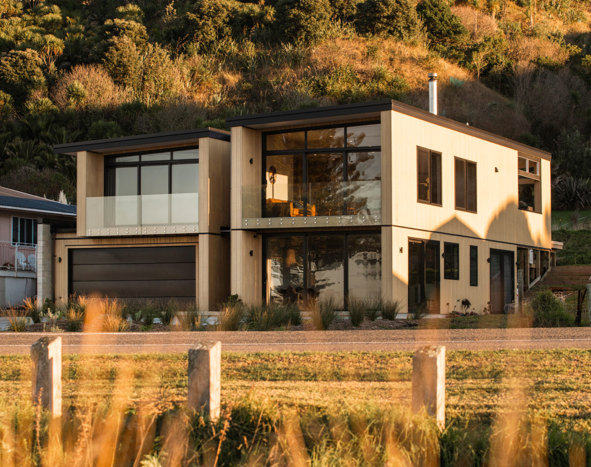 Coastal-Wainui-Home-Vulcan-Cladding-in-Straw-Finish-Abodo-Wood
